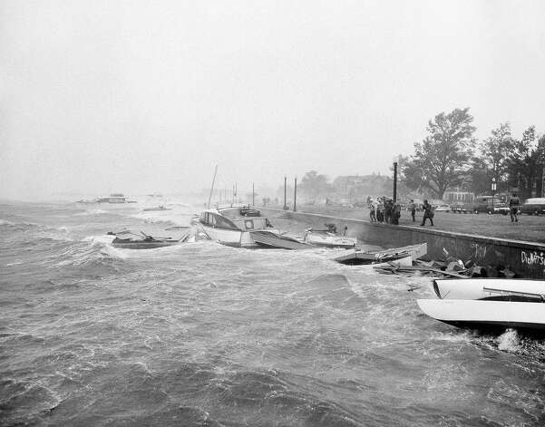 All types of boats and floats were driven ashore at the Boston Yachting Club on August 31, 1954, when a howling hurricane accompanied by fiercely driving rain struck New England. Residents along the sea coast were advised by the weather bureau to leave for higher ground. Photo: AP