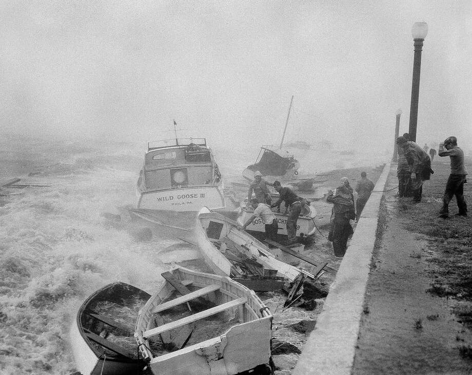 Rowboats and powerboats, including the Wild Goose III owned by Bob Pinto of Philadelphia, Pa., are aground at the Boston Yachting Club on August 31, 1954. In a howling hurricane the storm battered eastern Long Island and New England. Photo: AP