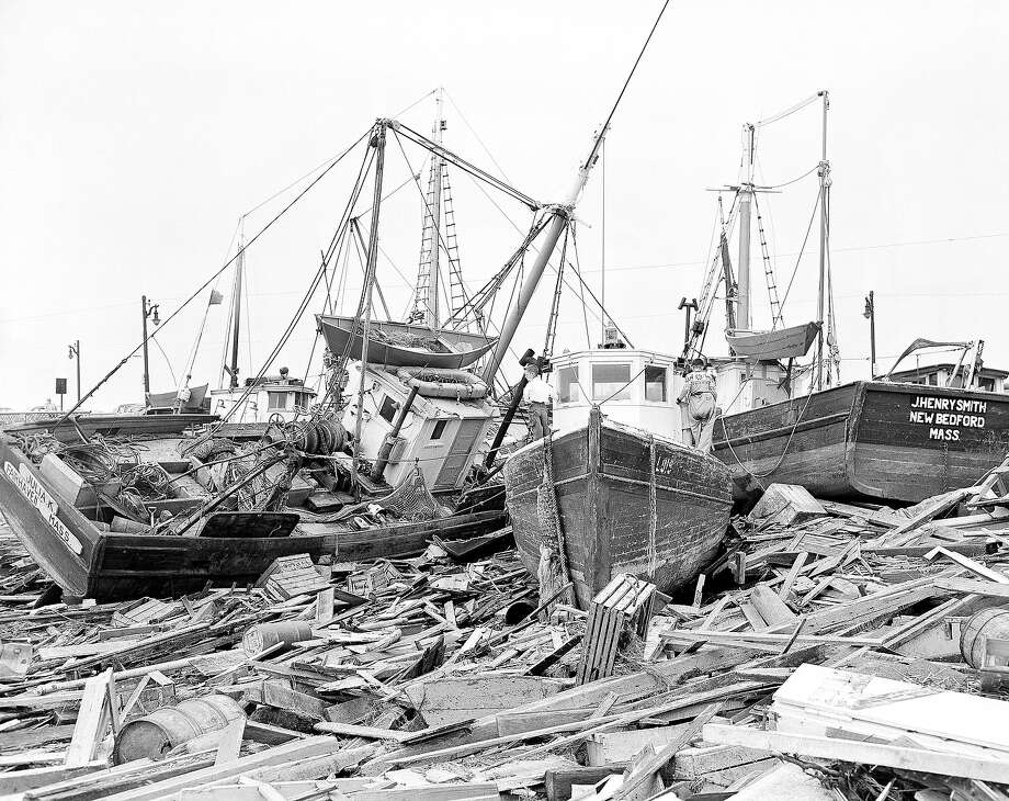 Fishing vessels out of New Bedford, Mass., left to right, the Julia K., Lois and J. Henry Smith are shown high and dry at Fairhaven, Massachusetts on Sept. 1, 1954, where they landed after the hurricane Carol swept them ashore, as it swept up the North Atlantic coast leaving in its wake millions of dollars worth of damage. Photo: AP