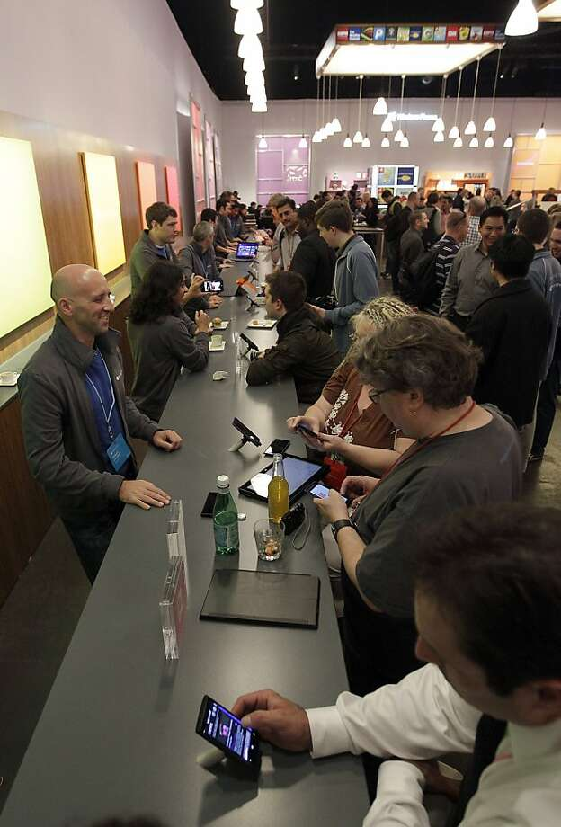 Attendees try out Windows Phone 8 operating system in San Francisco. Photo: Tony Avelar, Bloomberg