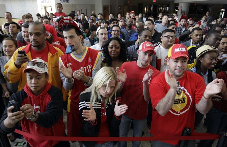 Rockets fans applaud as newly acquired guard James Harden speaks during Monday's news conference. (Melissa Phillip / Chronicle)
