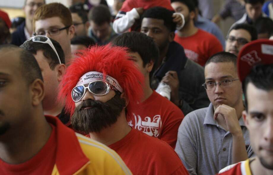 Rockets Red Rowdy Ruben Robles pay homage to the prominent beard of newly acquired guard James Harden. (Melissa Phillip / Chronicle)