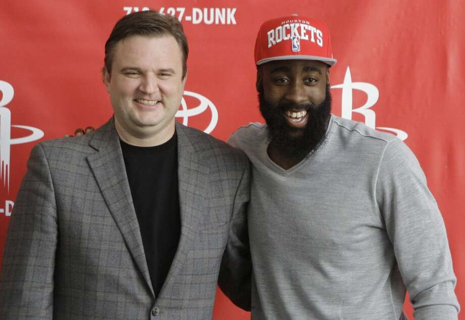 Daryl Morey, left, and James Harden pose for a picture after Monday's news conference. (Melissa Phillip / Chronicle)