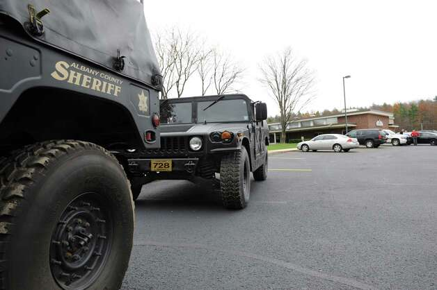 A couple of Humvees are parked outside the Albany County Sheriff's Office and Public Safety  & Community Resource Building which is set up as a shelter should Hurricane Sandy knock out power and wreak havoc on Monday, Oct. 29, 2012 in Clarksville, N.Y. The building used to be Clarksville Elementary School. (Lori Van Buren / Times Union) Photo: Lori Van Buren