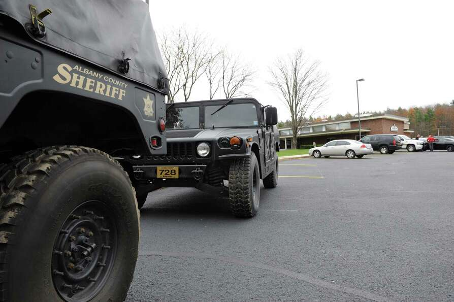 A couple of Humvees are parked outside the Albany County Sheriff's Office and Public Safety  & Commu