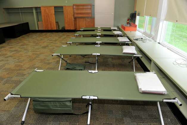 Cots are set up in a room at the Albany County Sheriff's Office and Public Safety  & Community Resource Building which is set up as a shelter should Hurricane Sandy knock out power and wreak havoc on Monday, Oct. 29, 2012 in Clarksville, N.Y. The building used to be Clarksville Elementary School. (Lori Van Buren / Times Union) Photo: Lori Van Buren