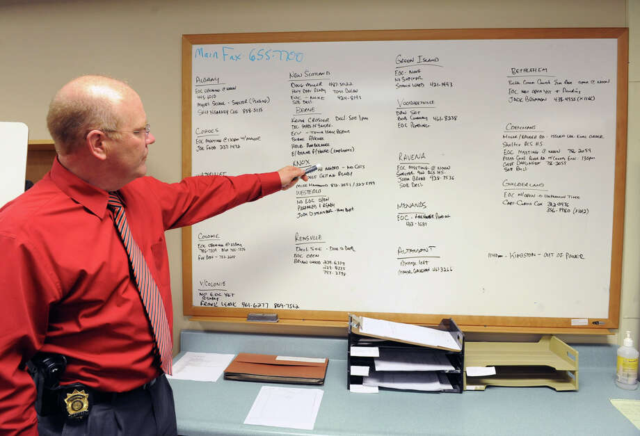 Captain John Layton, County Emergency Manager for Albany County Sheriff's Department Critical Incident - Emergency Management Unit, points to a dry erase board in the EOC (Emergency Operations Center) in the Albany County Sheriff's Office and Public Safety  & Community Resource Building on Monday, Oct. 29, 2012 in Clarksville, N.Y. The building is is set up as a shelter should Hurricane Sandy knock out power and wreak havoc. The board which Captain Layton is pointing to list other EOC's in the Capital District and the contact numbers. The building used to be Clarksville Elementary School. (Lori Van Buren / Times Union) Photo: Lori Van Buren