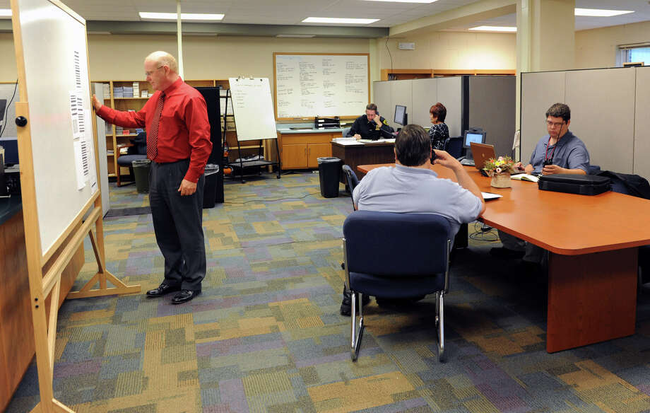 Workers at the EOC (Emergency Operations Center) in the Albany County Sheriff's Office and Public Safety  & Community Resource Building on Monday, Oct. 29, 2012 in Clarksville, N.Y. The building is is set up as a shelter should Hurricane Sandy knock out power and wreak havoc. The building used to be Clarksville Elementary School. (Lori Van Buren / Times Union) Photo: Lori Van Buren