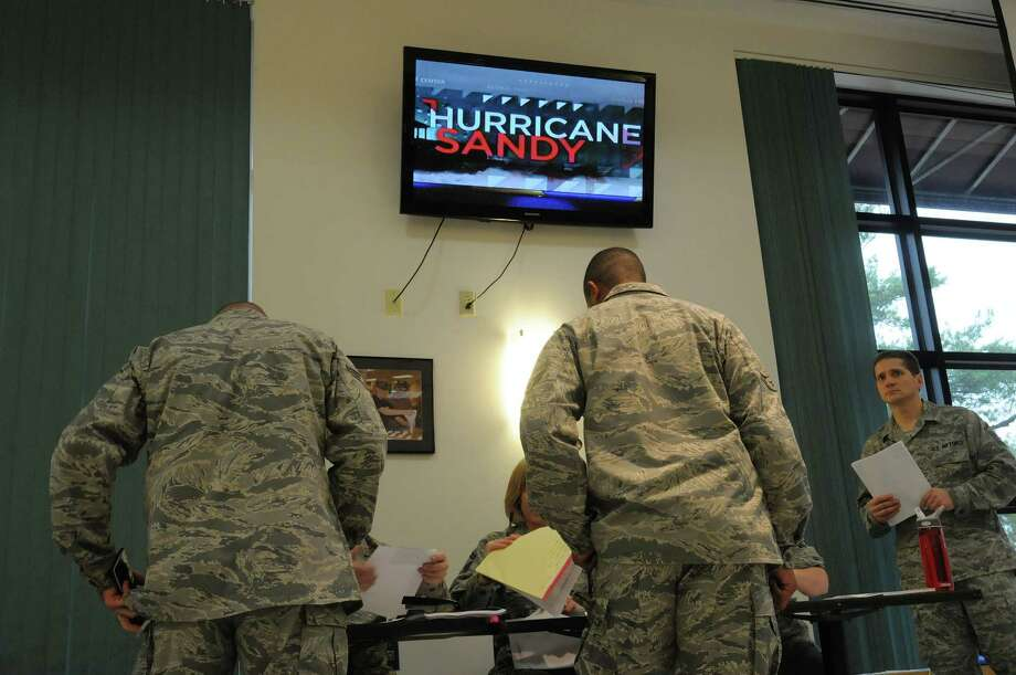 The Weather Channel is seen on a television  as members of the 109th Airlift Wing, Air National Guard are processed in at the Stratton Air National Guard Base on Monday, Oct. 29, 2012 in Glenville, NY.  (Paul Buckowski / Times Union) Photo: Paul Buckowski