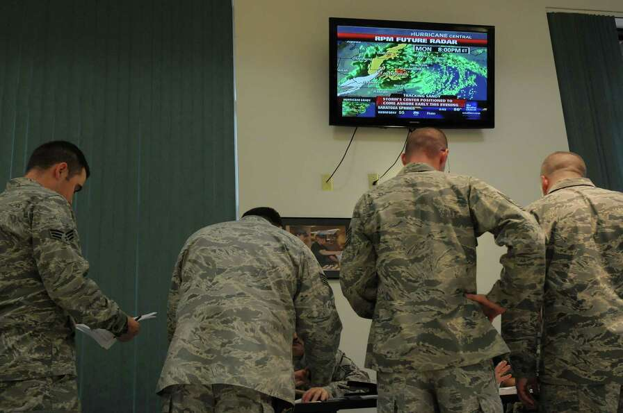 The Weather Channel is seen on a television  as members of the 109th Airlift Wing, Air National Guar