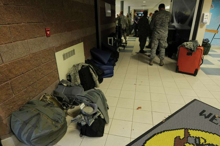 Bags of gear are seen in the hallway as members of the 109th Airlift Wing, Air National Guard are processed in at the Stratton Air National Guard Base on Monday, Oct. 29, 2012 in Glenville, NY.    (Paul Buckowski / Times Union) Photo: Paul Buckowski