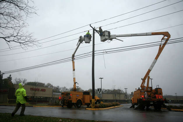 United Illuminating workers repair power lines damaged by Hurricane Sandy on Peck Lane in Orange near the Milford border on Monday, October 29, 2012. Photo: Brian A. Pounds