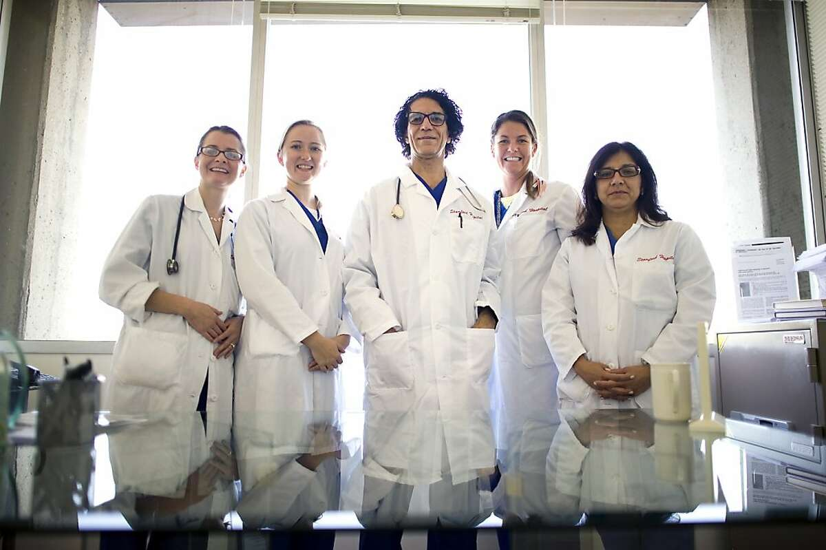Dr. Camran Nezhat (center) with colleagues who have teamed up on the endometriosis study.
