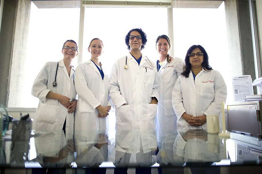 Dr. Camran Nezhat (center) with colleagues who have teamed up on the endometriosis study. Photo: Michael Short, Special To The Chronicle