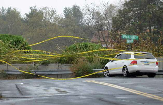 High winds blow the police tape that closed the flooded section of Pequot Ave near Southport Beach in Fairfield, Conn. on Monday, Oct. 29, 2012. Photo: Cathy Zuraw