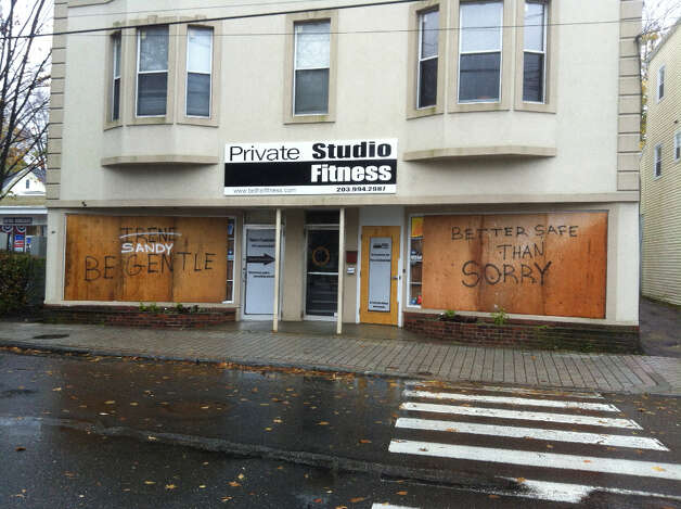 The owners of Private Studio Fitness on Greenwood Avenue in Bethel decided not to take any chances as tropical storm force winds approach the area. Be gentle Irene… I mean Sandy.  (Dirk Perrefort)
