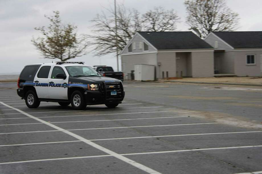 Darien Police patrol around Pear Tree Point Beach during the beginning of Hurricane Sandy. Oct. 29, 2012. Photo: Megan Davis