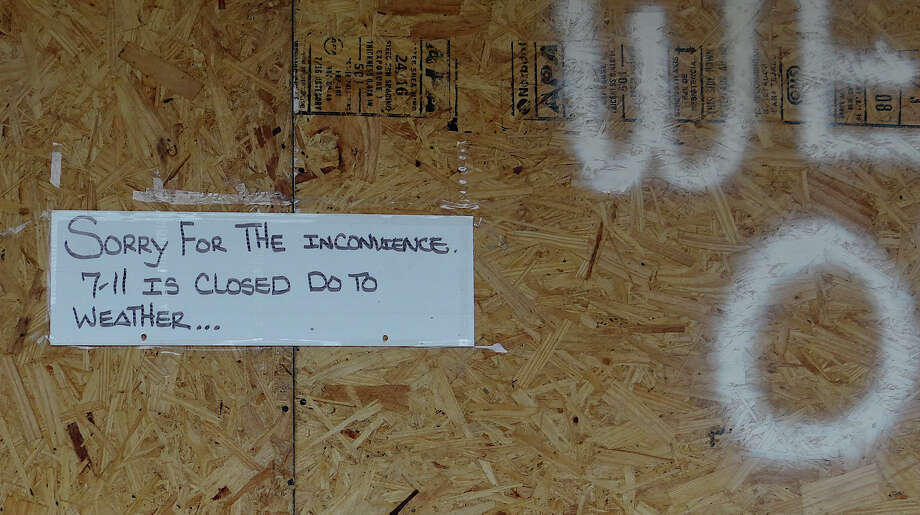 A sign taped to plywood affixed to the front of Seven-11 on Reef Road told coffee seekers the store is closed Monday in anticipation of Hurricane Sandy. Photo: Mike Lauterborn