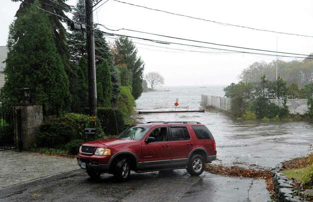 A vehicle on Byram Dock Street with two passengers views Hurricane Sandy in Byram, Monday afternoon, Oct. 29, 2012. Photo: Bob Luckey / Greenwich Time