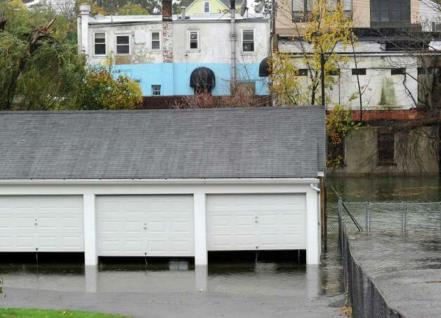 A flooded garage on Byram Road during Hurricane Sandy in Byram, Monday afternoon, Oct. 29, 2012. Photo: Bob Luckey / Greenwich Time