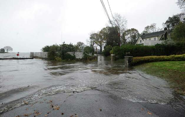Flood water makes its way up Byram Dock Street during Hurricane Sandy in Byram, Monday afternoon, Oct. 29, 2012. Photo: Bob Luckey / Greenwich Time