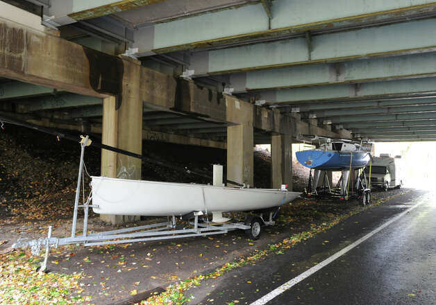 Boats on trailers parked underneath the I-95 overpass in Old Greenwich during Hurricane Sandy, Monday afternoon, Oct. 29, 2012. Photo: Bob Luckey / Greenwich Time