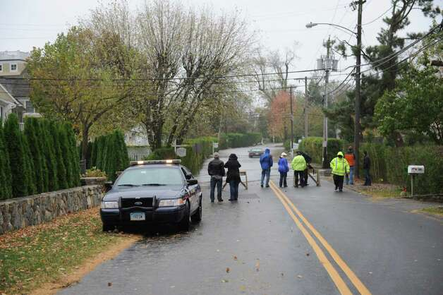 People watch the flood on Shore Road in Old Greenwich during hurricane Sandy Monday, Oct. 30, 2012. Photo: Helen Neafsey / Greenwich Time