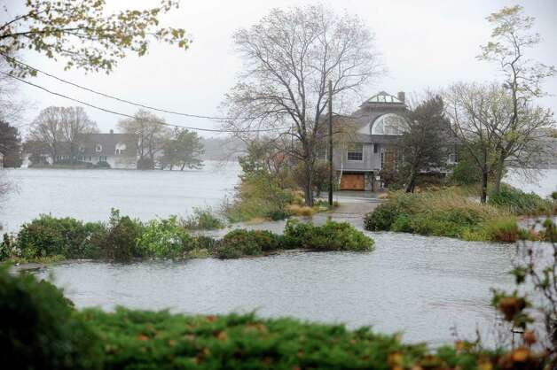 Houses that flooded during hurricane Sandy in Old Greenwich Monday, Oct. 29, 2012. Photo: Helen Neafsey / Greenwich Time