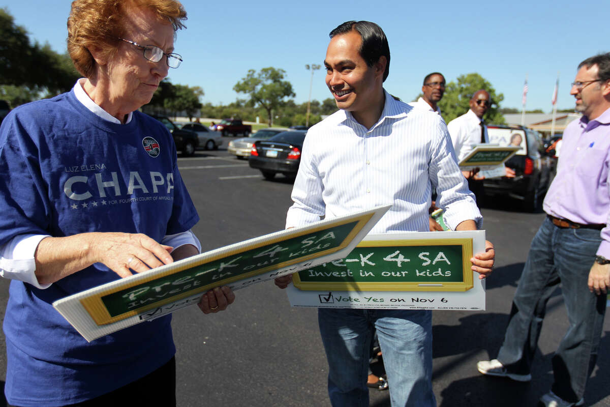 Mayor Julián Castro talks with supporter Sister Miriam Mitchell of the Convent of the Holy Spirit and Mary Immaculate as he campaigns outside the Claude W. Black Center last week.