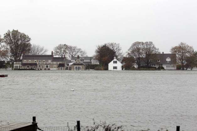 Homes along the perimeter of Tod's Point in Greenwich Conn. are engulfed with tidal surges as Hurricane Sandy weather hit the area on Monday, Oct. 29, 2012. Photo: J. Gregory Raymond