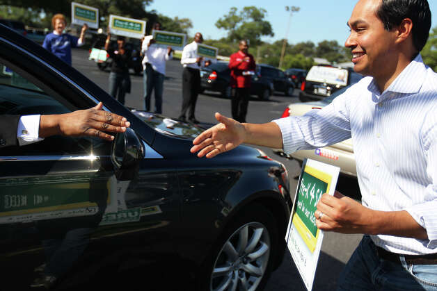 Mayor Julián Castro greets voters arriving after church as he campaigns for Pre-K for SA outside the Claude Black Center, Sunday, Oct. 28, 2012. Photo: Jennifer Whitney, For The Express-News / © Jennifer Whitney