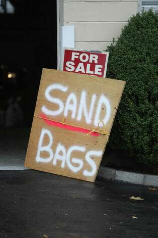 With Hurricane Sandy predicated to hit the Greenwich area on Monday evening at midnight, homeowners and businesses have sought sand bags to curb the possible effects of flooding . Photo: J. Gregory Raymond