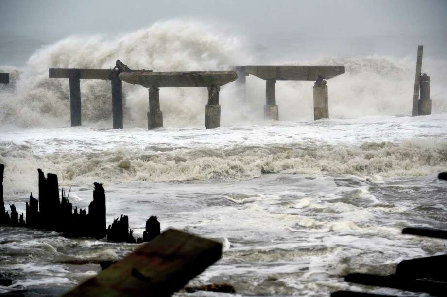 "Waves crash against a previously damaged pier before landfall of Hurricane Sandy October 29, 2012 in Atlantic City, New Jersey.   Storm-driven waves crashed ashore and flooded seafront communities across a swathe of the eastern United States as Hurricane Sandy barreled towards land.   Officials warned that the threat to life and property was ""unprecedented"" and ordered hundreds of thousands of residents in cities and towns from New England to North Carolina to evacuate their homes and seek shelter.    TOPSHOTS / AFP PHOTO/Stan HONDASTAN HONDA/AFP/Getty Images Photo: STAN HONDA, AFP/Getty Images / AFP"