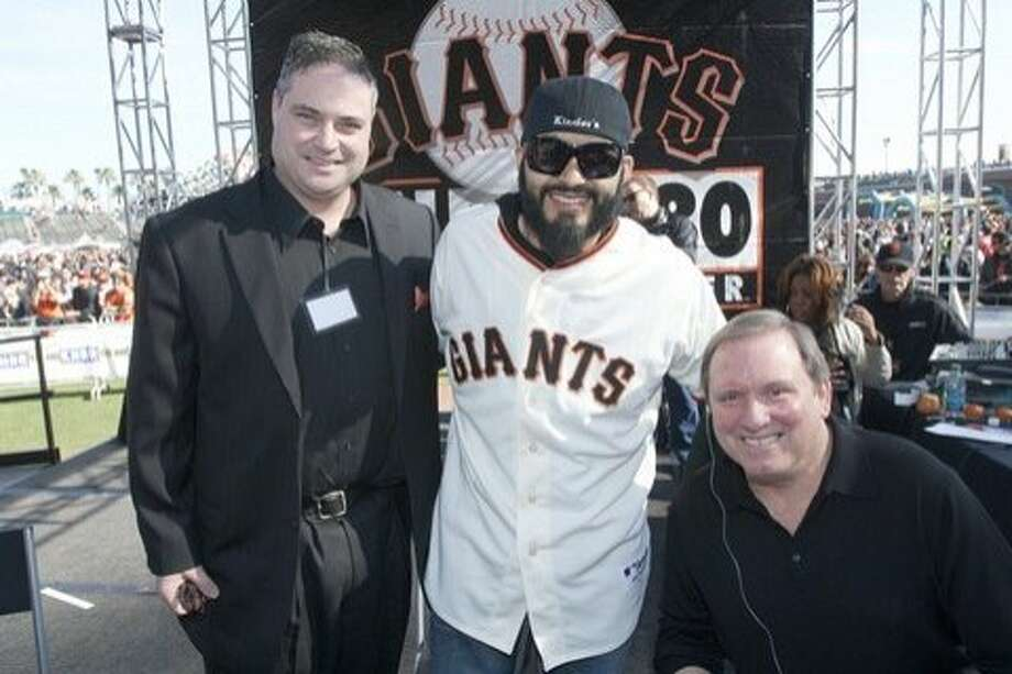 Gary Radnich (right) and co-host Larry Krueger flank Giants pitcher Sergio Romo at a KNBR Fan Fest. Photo: Knbr