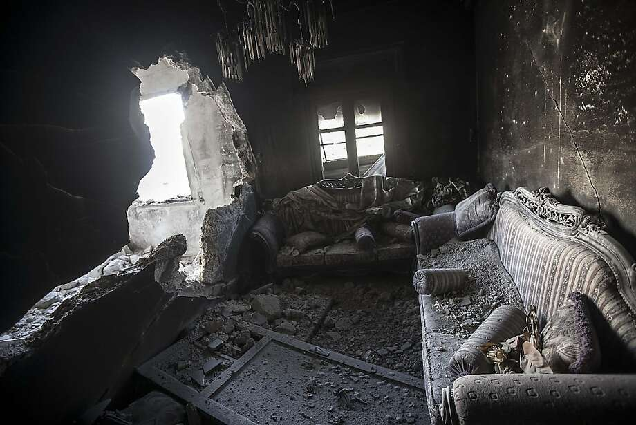Rubble litters an apartment destroyed by tank shelling in the Karm al-Jabel neighborhood of Aleppo, which has seen intense clashes between rebel fighters and the Syrian army. Photo: Narciso Contreras, Associated Press