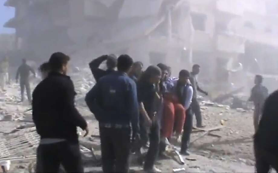 Syrians try to rescue the wounded after heavy bombing from military warplanes in Idlib, a rebel area the government has been attacking for months. Photo: Associated Press