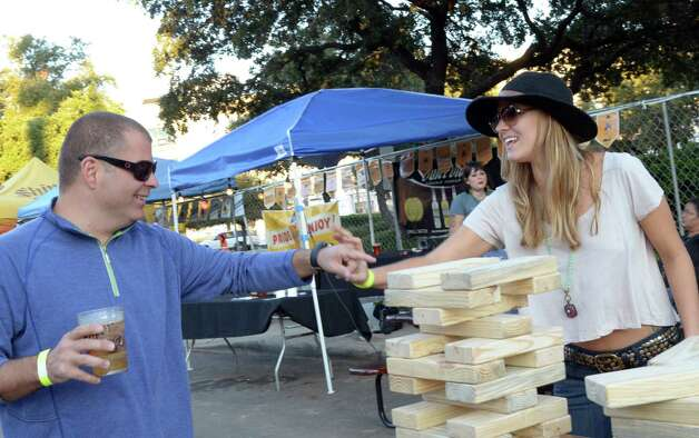 Cory and Rachel Tomer (cq) joke and play jumbo Jenga in the lot of Sam's Burger Joint on September 30, 2012. Robin Johnson Photo: Robin Johnson