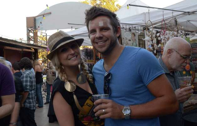 Clint and Ashlee Belew (cq) drink and check out the crafts show at Sam's Burger Joint on September 30, 2012. Robin Johnson Photo: Robin Johnson