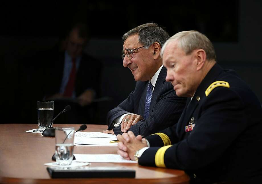 Defense Secretary Leon Panetta (left), Joint Chiefs of Staff Chairman Martin Dempsey discuss Libya. Photo: Alex Wong, Getty Images