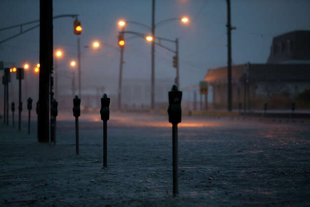 Ocean Avenue is flooded caused by Hurricane Sandy, on October 29, 2012 in Cape May, The New Jersey coastline is feeling the full force of Sandy's heavy winds and record floodwaters. Photo: Mark Wilson, Getty Images / 2012 Getty Images