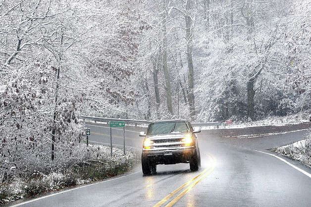 Snow sticking to tree limbs on Grandview Road in Beckley, V.Va. Monday Oct. 29, 2012 as Hurricane Sandy wheeled toward land as forecasters feared Monday, raking cities along the Northeast corridor with rain and wind gusts, flooding shore towns, washing away a section of the Atlantic City Boardwalk, and threatening to cripple Wall Street and New York's subway system with a huge surge of corrosive seawater. Photo: Rick Barbero, AP / AP2012