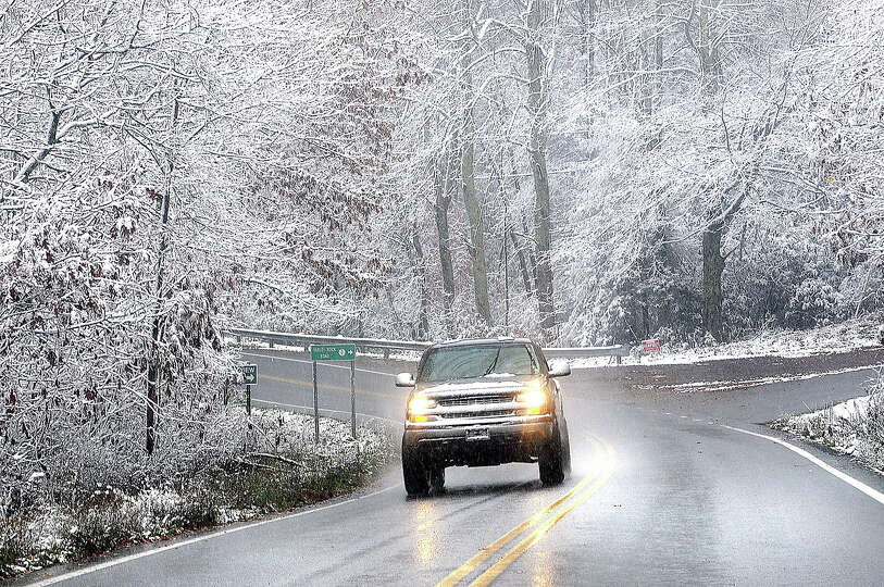 Snow sticking to tree limbs on Grandview Road in Beckley, V.Va. Monday Oct. 29, 2012 as Hurricane Sa