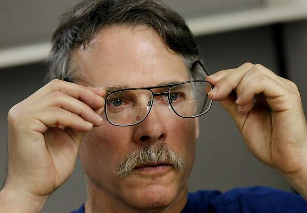 Adam Chedister tries on the glasses he got through S.F.'s new Every Day Connect, a version of Project Homeless Connect. Photo: Brant Ward, The Chronicle