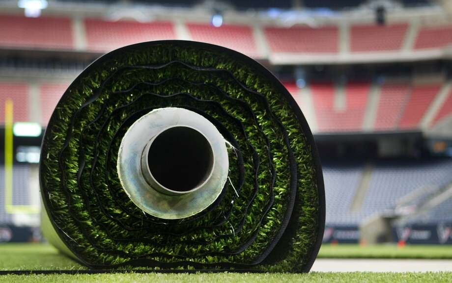 A roll of AstroTurf before it's placed on the surface of Reliant Stadium. (Cody Duty / Houston Chronicle)