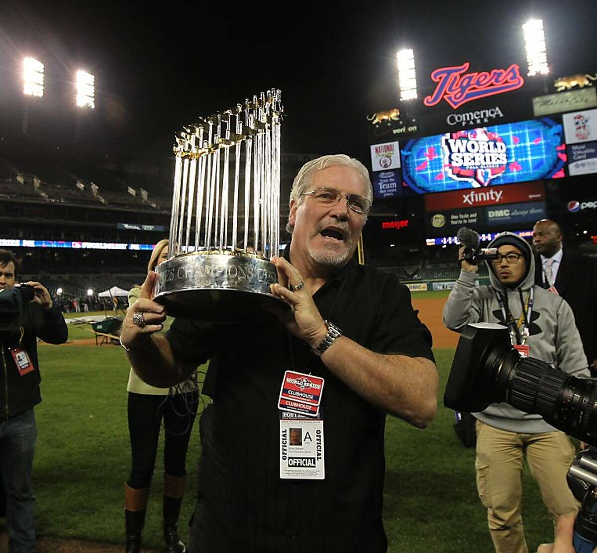 Brian Sabean holds the championship trophy after game 4 of the World Series at Comerica Park on Sunday, Oct. 28, 2012 in Detroit, MI.