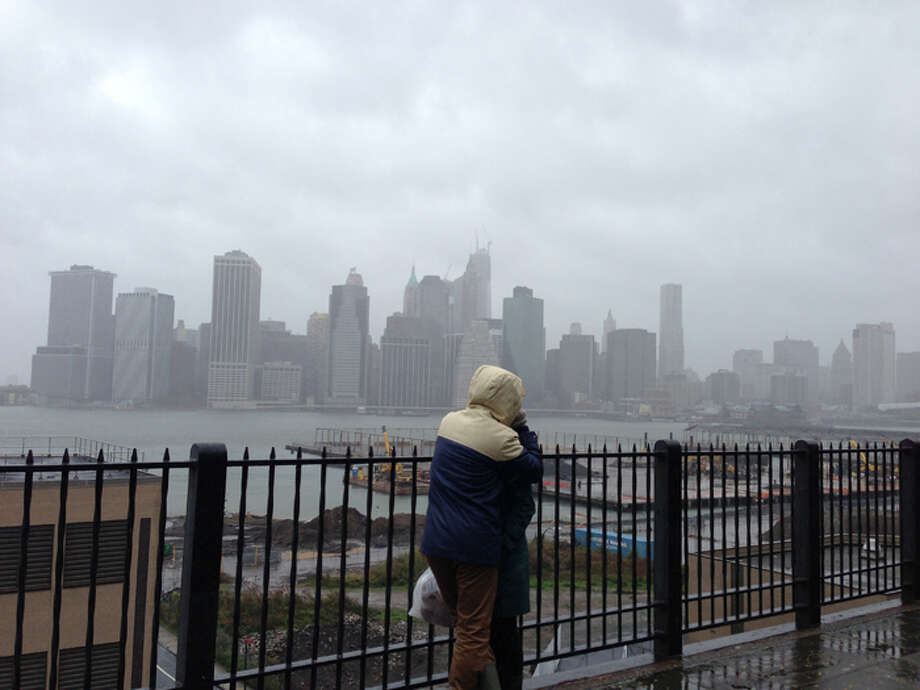 "The skyline of lower Manhattan as seen from Brooklyn just hours before Hurricane Sandy, now dubbed a ""superstorm"" because it's no longer considered a tropical storm, hit the New Jersey coastline. Photo: Nolan Hicks/Express-News"