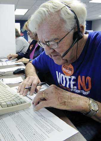 In this Oct. 23, 2012, photo, Joe Norquist, a retired doctor, calls fellow senior citizens from a Shoreview, Minn, phone bank to urge them to vote against a proposed constitutional ban on gay marriage on Minnesota's statewide ballot next month. The phone bank was sponsored by Minnesotans United for All Families, the campaign trying to defeat the amendment. (AP Photo/Jim Mone) Photo: Jim Mone, Associated Press