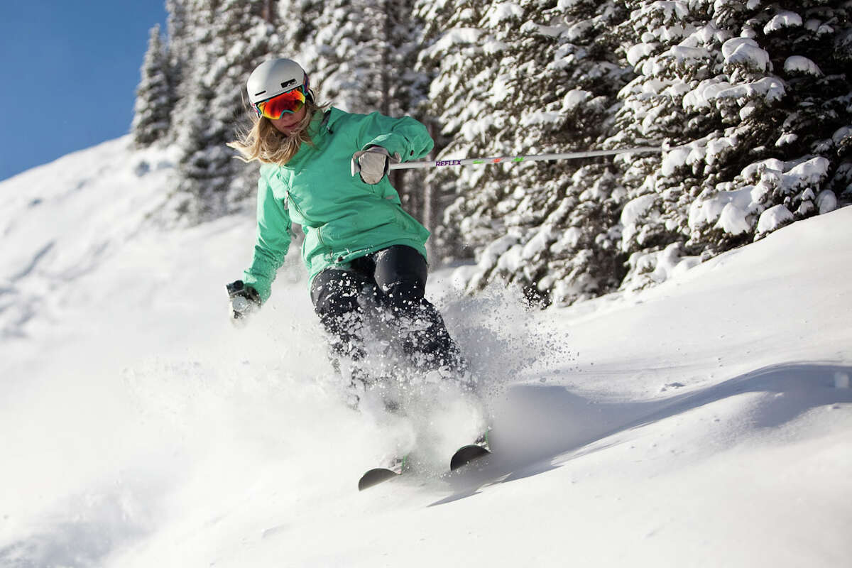 A skier tackles 14 inches of fresh powder on the slopes at Aspen/Snowmass in January.