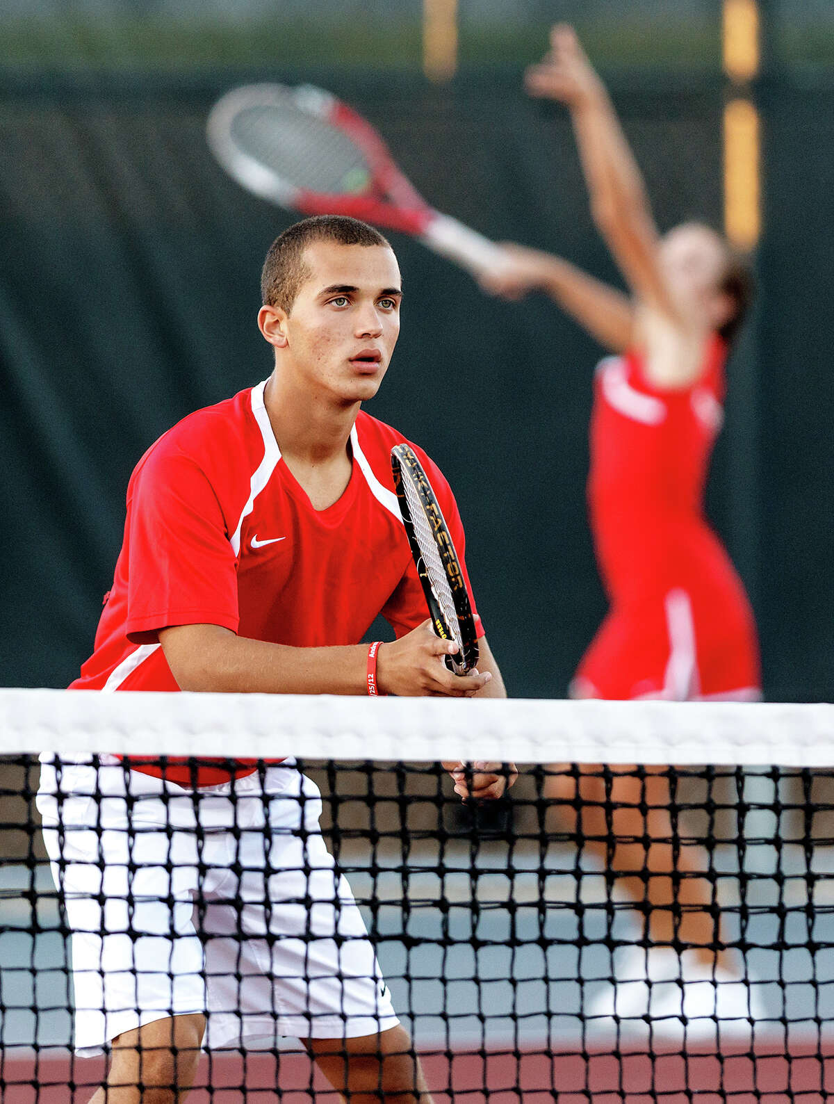 Judson's Francisco Cruz-Torres waits at the net as Megan Ingram serves in mixed doubles during their District 25-5A tennis match with Smithson Valley at Judson High School on Oct. 18, 2012. The duo won their match 6-2, 6-4. Photo by Marvin Pfeiffer / Prime Time Newspapers