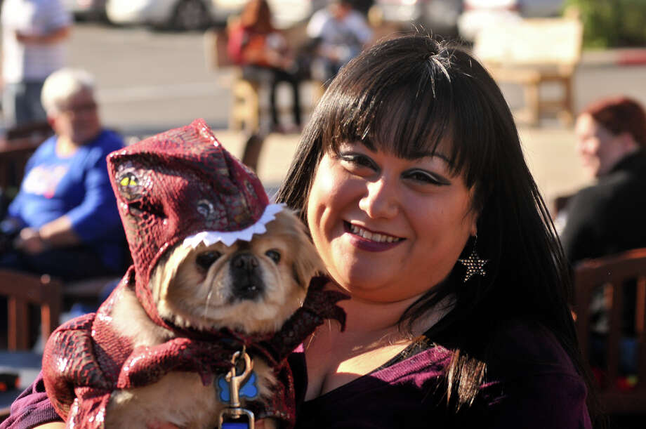 "Catherine Perez poses with her dog, Sam, during the San Antonio Humane Society's ""Paws on the Patio"" event at the Canyon Cafe Monday afternoon.. Photo: Robin Jerstad/For The Express-Ne"